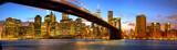 Manhattan skyline panorama with Brooklyn Bridge at dusk, New York