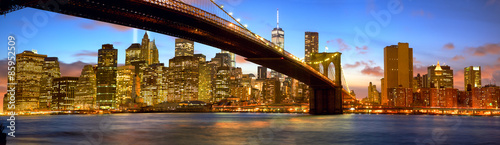 Manhattan skyline panorama with Brooklyn Bridge at dusk, New York