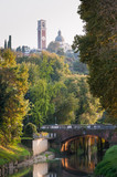 Retrone river and trees with the sanctuary of Mount Berico seen from Furo bridge, Vicenza poster