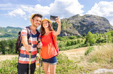 Fototapety couple take a selfie during their trip - technology, people and holidays concept