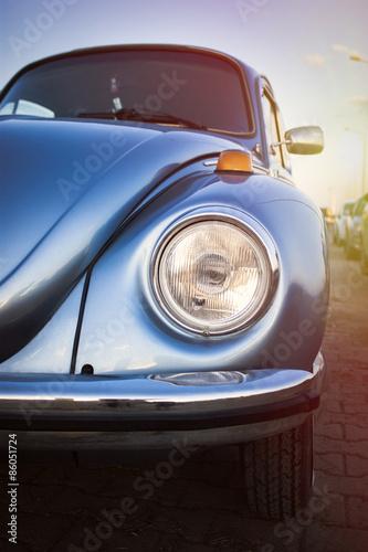 Headlight of a volkswagen beetle Poster