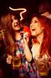 Obrazy na płótnie, fototapety, zdjęcia, fotoobrazy drukowane : Girls having fun and drinking beer in night club
