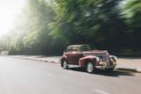 Retro car speed ride on road