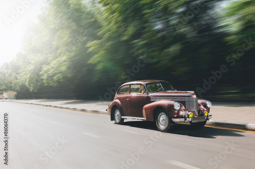 Retro car speed ride on road