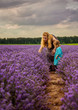 Mother and daughter picking lavender at sunset