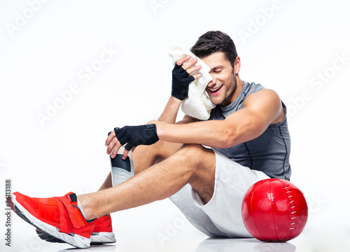 Fitness man resting on the floor Poster