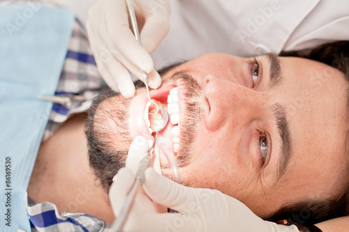 young happy man and woman in a dental examination at dentist Poster