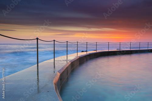 Sunrise seascape and rock pool in Bronte rock pool, Sydney, Australia.