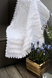 Crochet, Cable Knit Afghan Baby Blanket in White on Sofa with Lavender, Soft Focus High Contrast Desaturated Grunge Filter  - 86193740