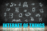 Internet of Things (IoT) word on wood floor with doodle icon on poster