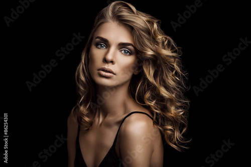 Vogue style close-up portrait of beautiful woman with long curly Poster