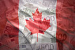 colorful waving canadian flag on a euro money background