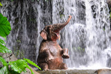 Fototapety Elephant is bathing at the waterfall