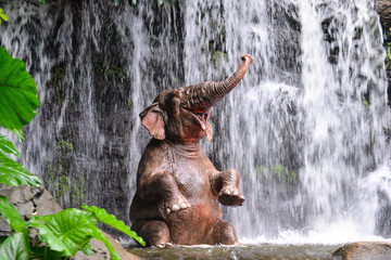 Elephant is bathing at the waterfall