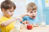 Fototapety cute children eat healthy food enjoying breakfast