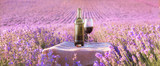 Fototapety Bottle of wine against lavender.