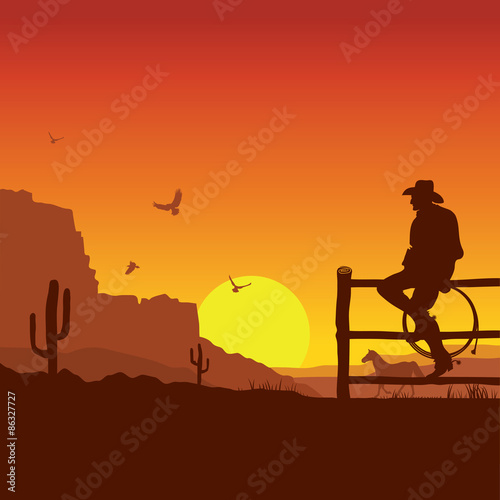 Fotobehang Bruin American Cowboy on wild west sunset landscape in the evening