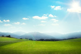 Fototapety landscape of green meadow with hills