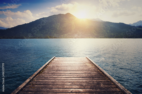 landscape with lake, moorage and hills Poster