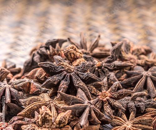 Foto op Canvas Klaprozen Star anise spice over wicker background