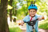 Fototapety Cute little boy on bike