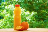 Fototapeta Orange and juice on the table