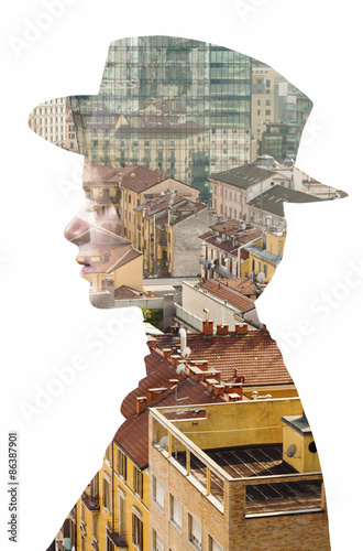 Double exposure of girl wearing hat and cityscape - 86387901