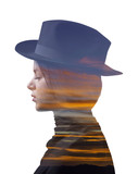 Double exposure of girl wearing hat and colorful sunset