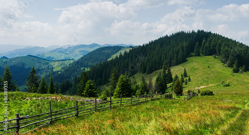 Mountain panorama with wooden fence