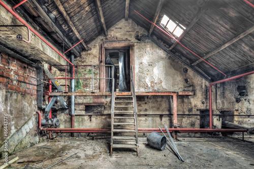 Staande foto Industrial geb. Metal staircase in an abandoned workshop
