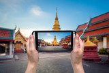 hand woman taking photo at wat phratad haripunchai in lamphun, t