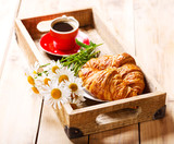 Fotoroleta breakfast tray with croissants, cup of coffee and daisy flowers