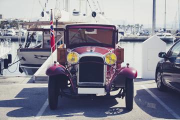 Vintage car at port.