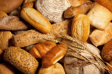 assortment of baked bread with wheat