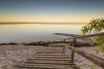 Landscape with wooden stairs leading to the sea © milosz_g