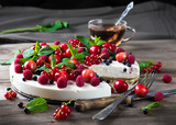 Fototapeta Cheesecake with berries and mint, summer dessert.
