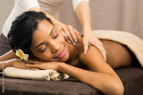 Therapist doing massage Poster