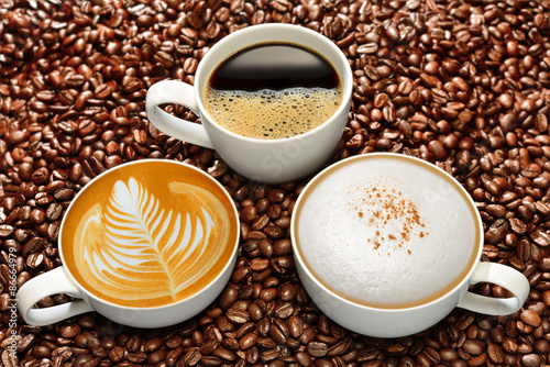 Fototapeta Variety of cups of coffee on coffee beans background