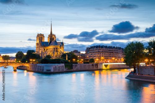 Foto op Canvas Notre Dame de Paris Cathedral and Seine River at night