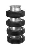 Stack of car wheels and tires.