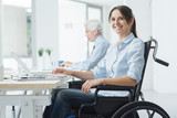 Fototapety Smiling business woman in wheelchair