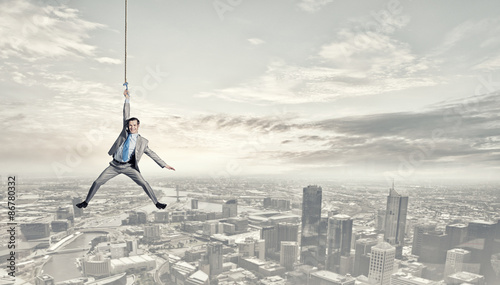 Man hang on rope - 86780332