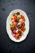 Colorful tomato salad with fresh parsley