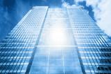 Fototapeta Sun reflecting in modern business skyscraper, high-rise building,