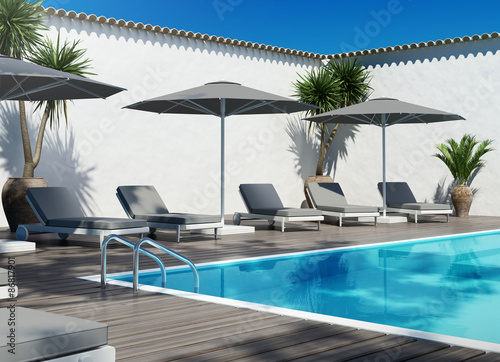 Grey unbeds lounge by the pool, summer holiday