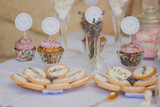 Dessert table for a wedding party. Biscuits decorated with