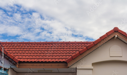 Staande foto Industrial geb. red rooftop against blue sky