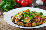 Vegetable Ratatouille in white plate on a wooden table - 86848781