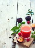 Fototapeta Juice of plums and berries