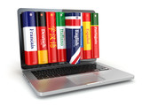 Fototapety E-learning. Learning languages online. Dictionaries and laptop.